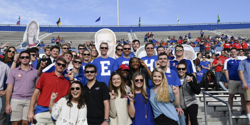 Dr. Les Guice enjoys a Louisiana Tech football game with students.