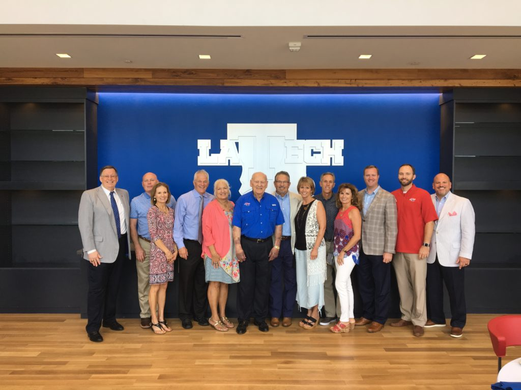 Leo Sanford poses for a photo with his family and Louisiana Tech administrators.