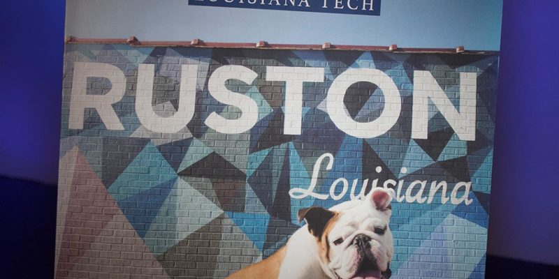 Cover photo of 1894 The Alumni Magazine featuring Tech XXII in front of the Ruston geodesic mural.