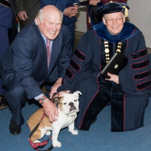 Terry Bradshaw and Dr. Guice pose with Tech XXII before the 2019 Spring Commencement.