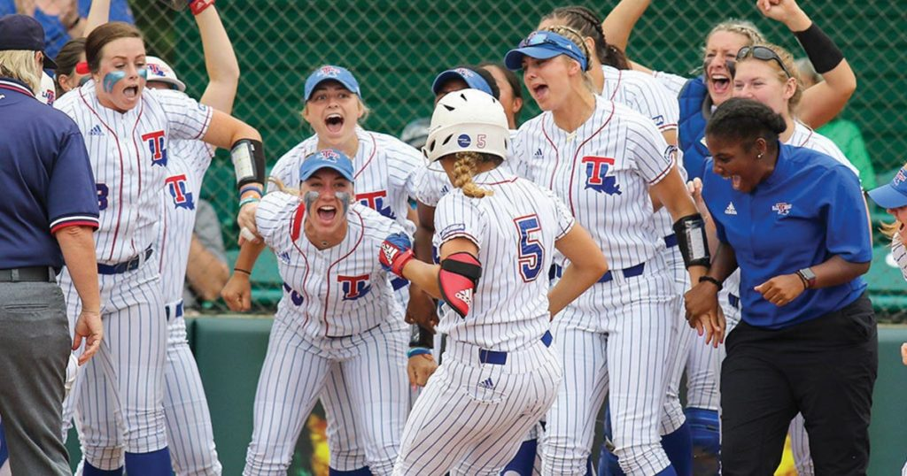 Lady Techsters softball scoring against Marshall.