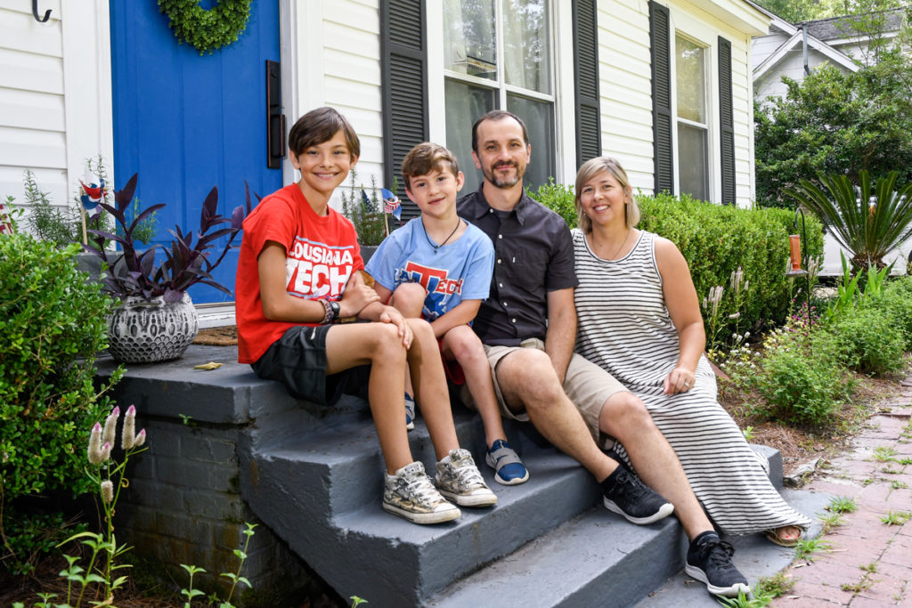 Tech faculty members Lacey and Brad Deal and their sons Finn and Oli hang out in front of their Ruston home.