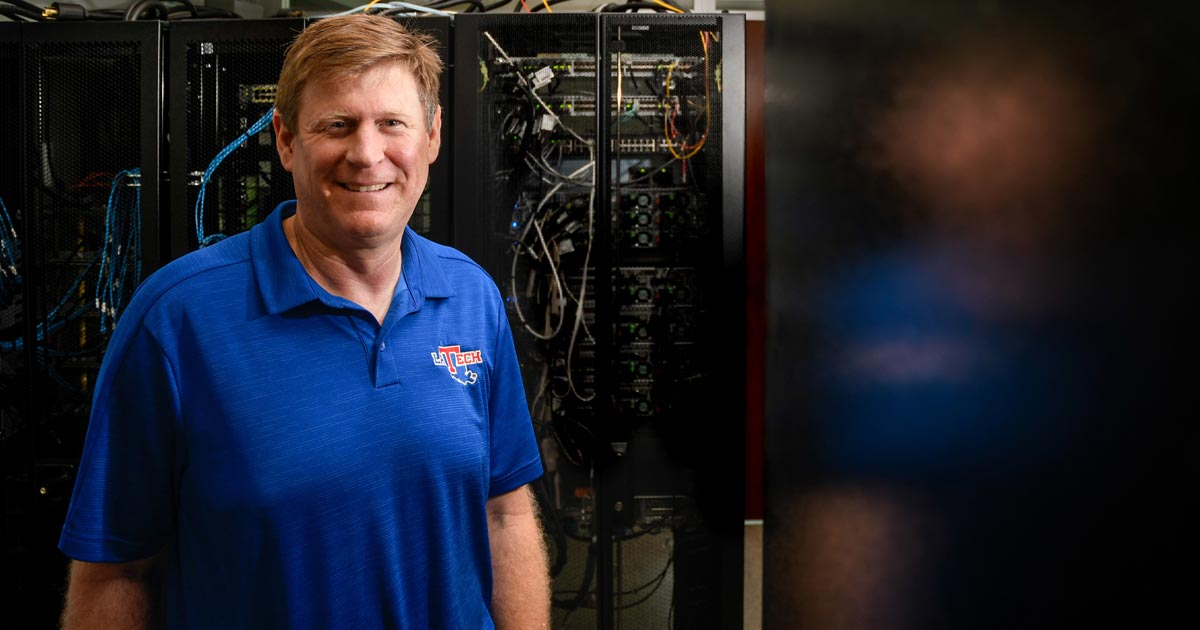 Tom Hoover standing in front of a server at Louisiana Tech.