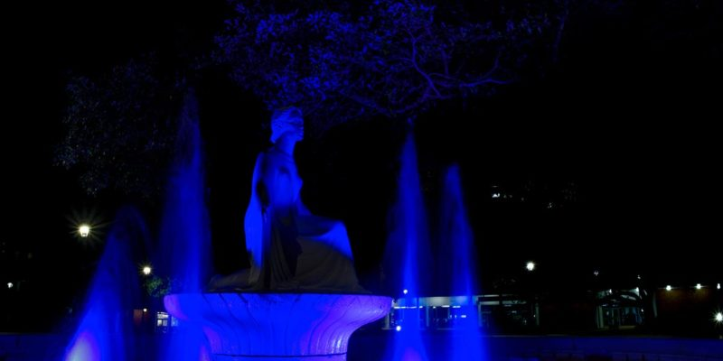The Lady of the Mist lit in blue.