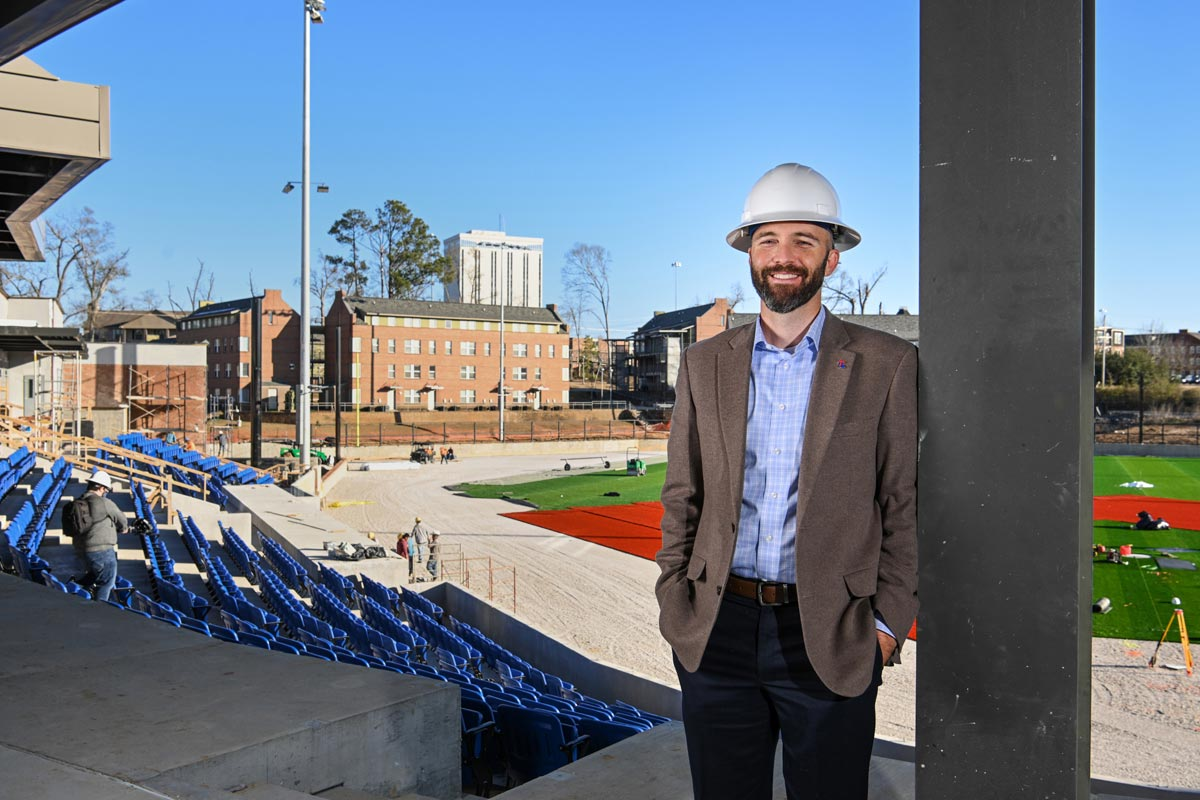 Adam McGuirt poses for a photo from the new baseball facility.