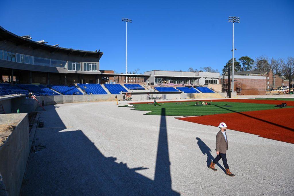 Adam McGuirt surveying the new baseball turf.
