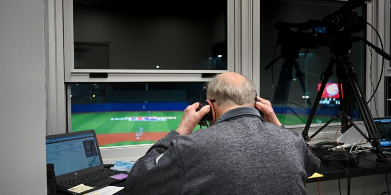 Dave Nitz overlooks the baseball field while broadcasting.