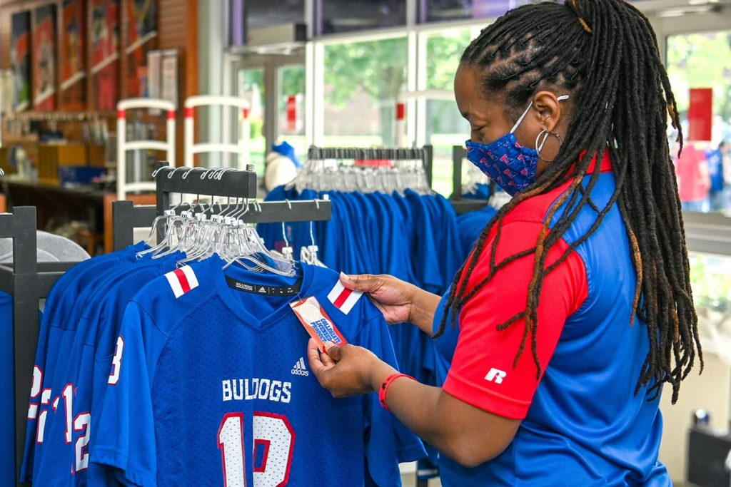 A fan shops for officially licensed apparel at the bookstore.